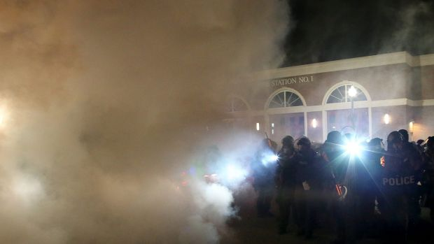 Police deploy tear gas on protestors during a demonstration in Ferguson.