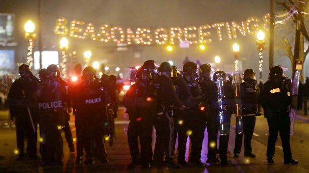 Police gather on the streets of Ferguson after the announcement of the grand jury's decision.