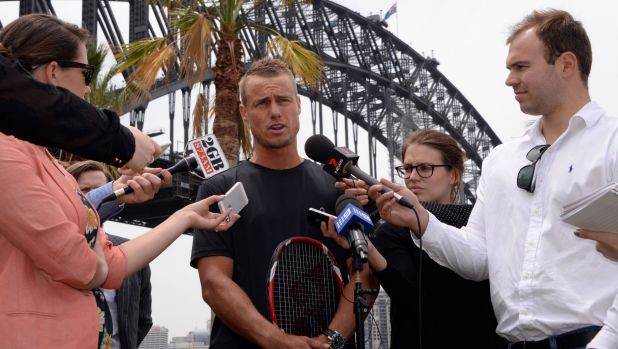 Old and new: Veteran Lleyton Hewitt speaks to the media on Tuesday about his clash with Roger Federer and the new tennis ...