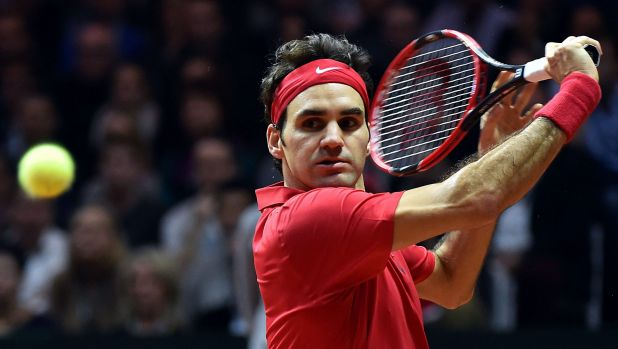 Class act: Roger Federer on his way to sealing the Davis Cup for Switzerland.