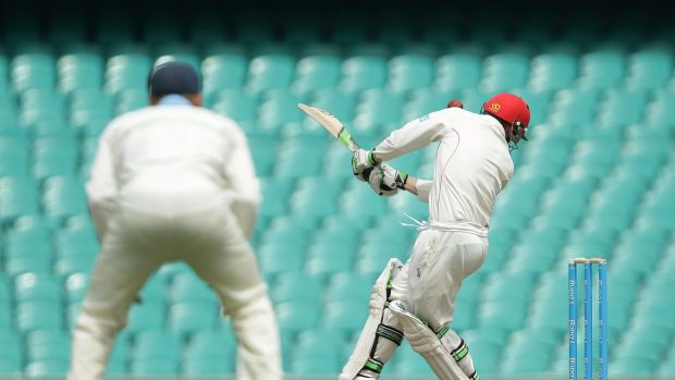 Phil Hughes is struck by Sean Abbott's bouncer at the SCG.