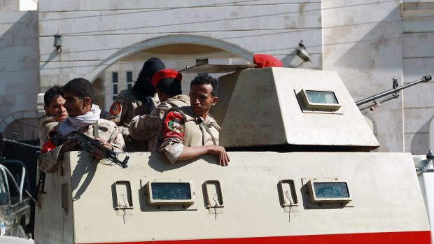 Yemeni security forces have freed eight hostages in a raid on al-Qaeda in Sanaa.