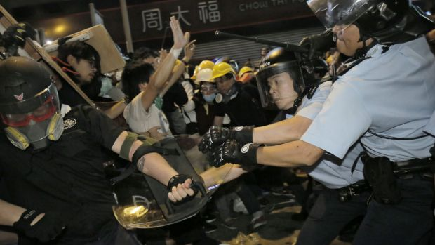 Physical confrontation: Police and protesters clash in Hong Kong.