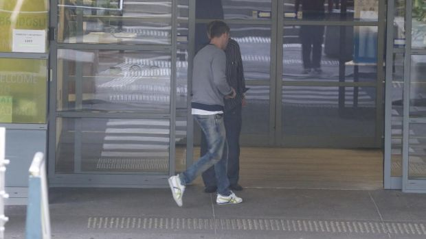 Showing support: Michael Clarke arrives at St Vincent's Hospital on Wednesday morning.
