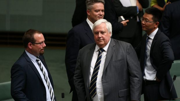 Clive Palmer talks to colleagues after  Chinese President Xi Jinping's recent address to parliament.