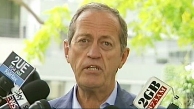 Australian team doctor Peter Brukner addresses the media on Wednesday.