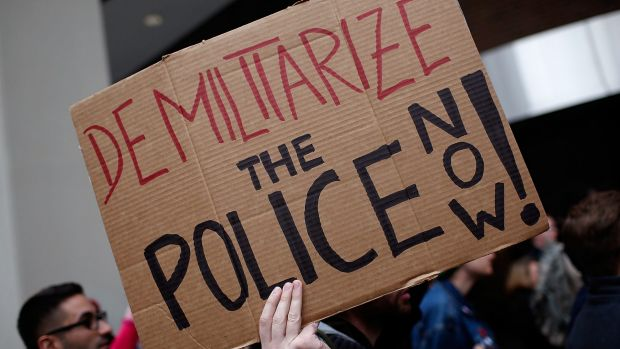 """Critical crowd: Demonstrators take part in a protest outside the Office of Police Complaints as part of a planned """"28 ..."""