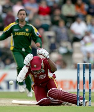 Brian Lara falls to the ground after being hit by a ball bowled by Pakistan's Shoaib Akhtar in 2004.