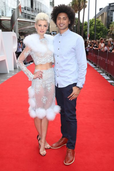 Kate Peck and Krit Schmidt arrive at the 2014 ARIA Awards.