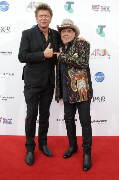Richard Wilkins and Molly Meldrum arrive on the red carpet at the 2014 ARIA Awards.