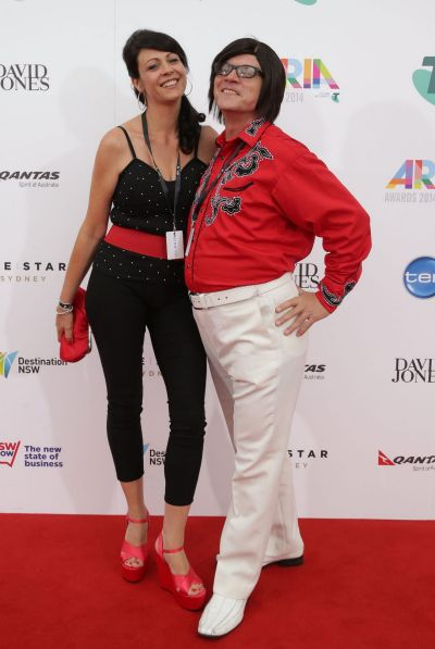 Buddy Goode and Lisa Scelzi arrive at the 2014 ARIA Awards.