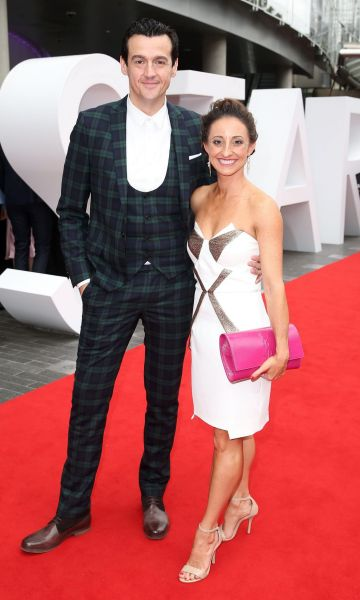Sam Moran and guest arrive at the 2014 ARIA Awards.
