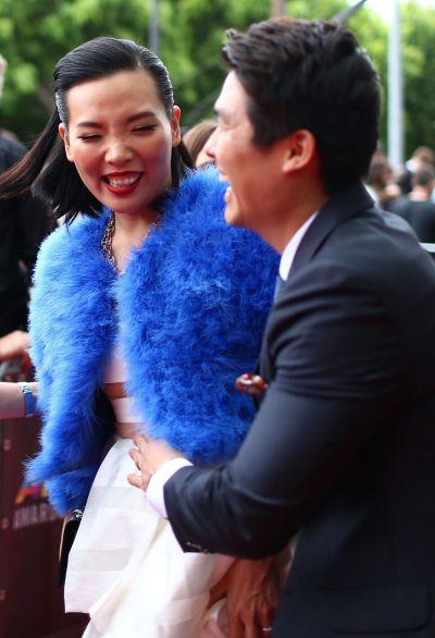 Dami Im and her husband Noah Kim arrive at the 2014 ARIA Awards red carpet.