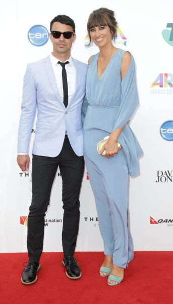 Lance Ferguson and guest arrive at the 2014 ARIA Awards.