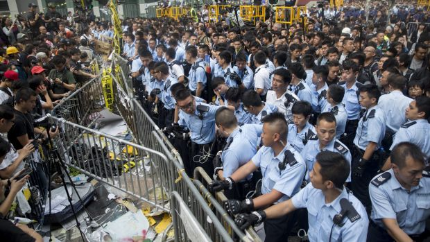 Police near a barricade on Nathan Road in Mong Kok.