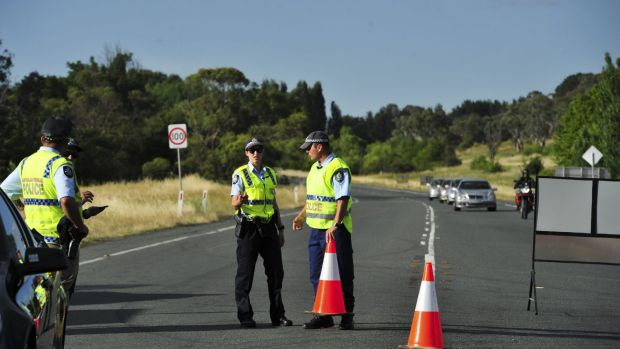 Police secure   the crash site on the Monaro Highway.
