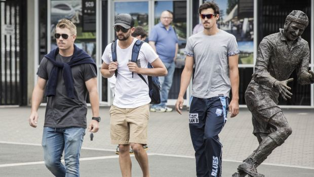 NSW cricketers David Warner, Nathan Lyon and Mitchell Starc leave the SCG after a squad meeting following the Phillip ...
