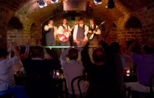 Entertainment: Beatles tribute band onstage inside The Cavern Club, Liverpool.