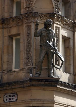 Eyecatching: A statue of John Lennon adorns the facade of the newly opened Hard Days Night Hotel.