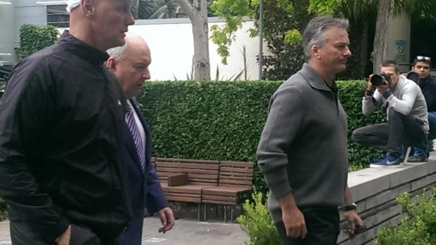Alan Jones, Steve Waugh, right, and  Channel Ten reporter Andrew Denney, left, leave the hospital together.