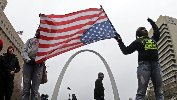 Protesters stand in front of the Gateway Arch - a famous tourist destination and monument known as 'the gateway to the ...