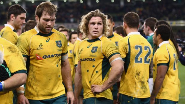 'It's news that you never want to wake up to' ... Wallabies captain Michael Hooper, centre, on the loss of Phillip Hughes.