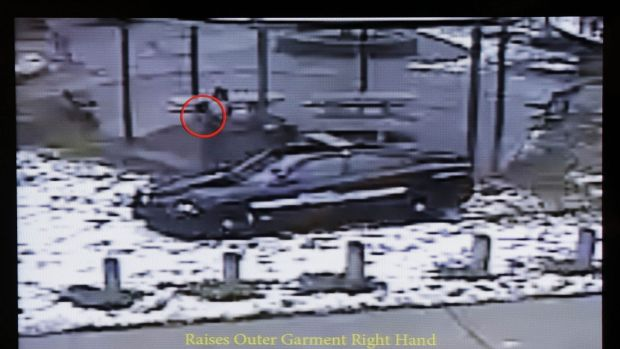 This still image taken from a surveillance video played at a news conference held by Cleveland Police shows police ...