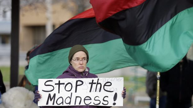 A demonstrator protests the shooting of Tamir Rice at Cudell Park in Cleveland.