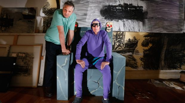 Ghostly canvas: Artists Euan Macleod and Peter Kingston with some of the Phantom-inspired work.
