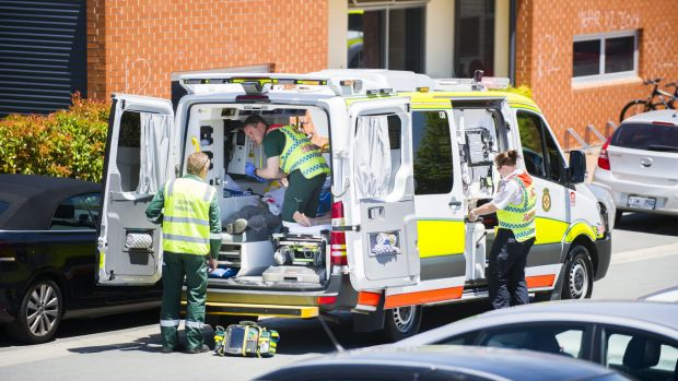 Paramedics treat students and teachers after an explosion between sugar and sulphuric acid in a year 9 class at Burgman ...