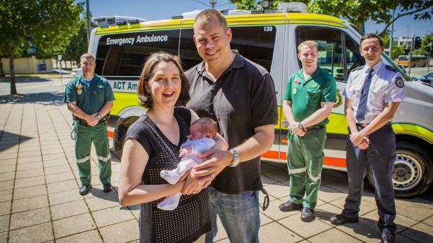 Calli and Chris Bowyer with 2-week-old Maisie, who was born on the side of Gunghalin Drive, reunite with their paramedic ...
