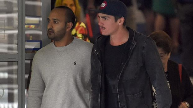 Grief: Sean Abbott, right, leaves St Vincent's Hospital on Thursday.