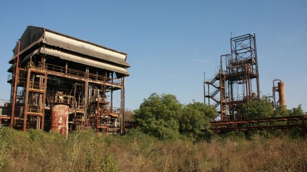 The two main structures of the derelict pesticide plant, which still have not been dismantled three decades on from the ...