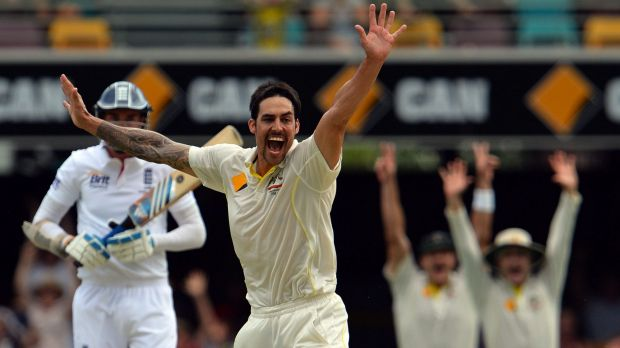 Mitchell Johnson celebrates the dismissal of England's Stuart Broad during the first Ashes Test at the Gabba in Brisbane ...