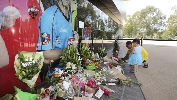The Australian public pay tribute to Phillip Hughes outside the Adelaide Oval.
