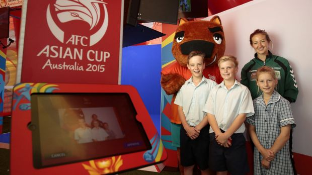 AFC Asian Cup mascot Nutmeg, Canberra United player Grace Gill, front from left, Trinity Christian School year 7 student ...