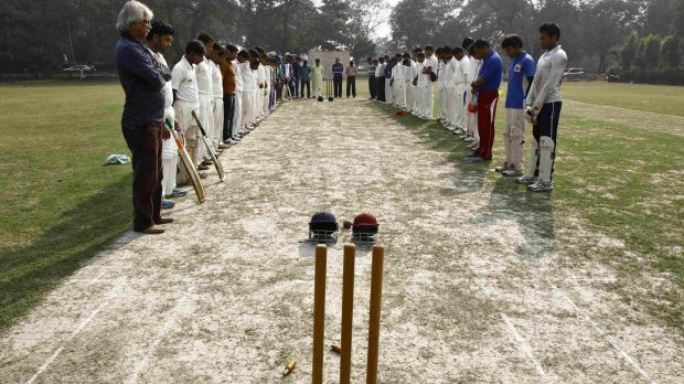 Indian players observing a moment of silence before a match in Kolkata.