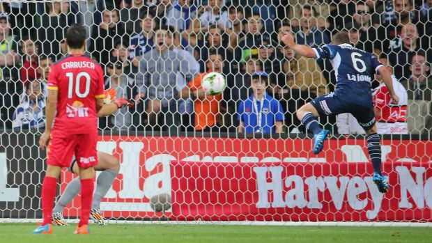Victory's Leigh Broxham heads home against Adelaide United at AAMI Park on Friday.