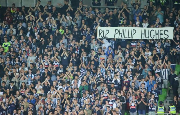 Melbourne Victory supporters display a banner in tribute of Phillip Hughes ahead of the A-League match against Adelaide ...