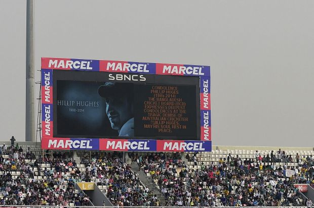 A tribute to Phillip Hughes is displayed on the scoreboard during the fourth ODI between Bangladesh and Zimbabwe in Dhaka.