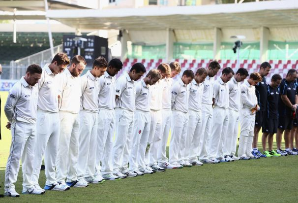 New Zealand cricket players wear black armbands and observe a minute's silence during day two of the third test between ...
