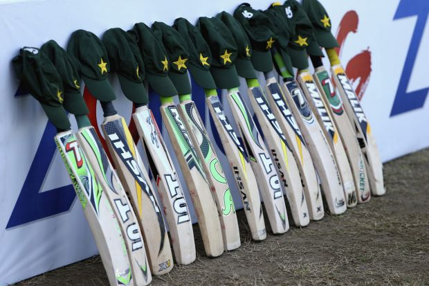 Bats and caps are placed outside the Pakistan dressing room in memory of Australian cricketer Phillip Hughes.