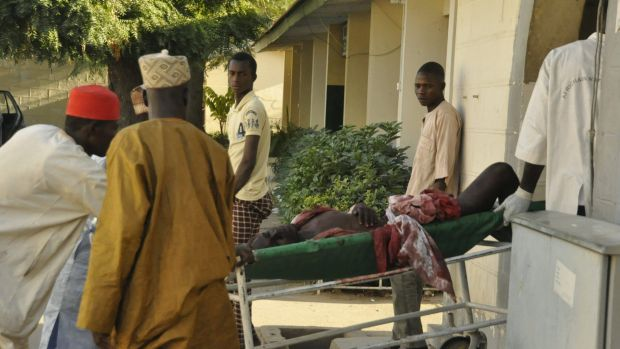 A injured man is wheeled into hospital, following an explosion at a Mosque, in Kano, Nigeria,