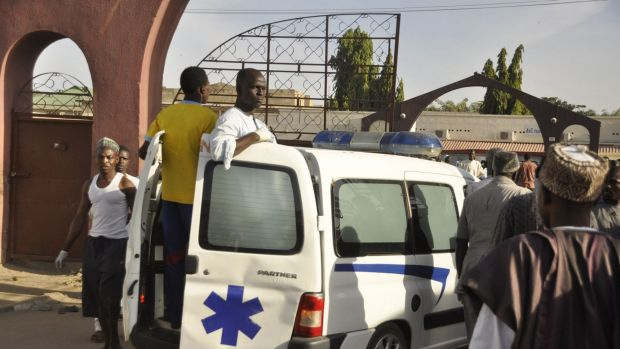 An ambulance enters the premises of the Kano Central Mosque after a gunmen set off three bombs.