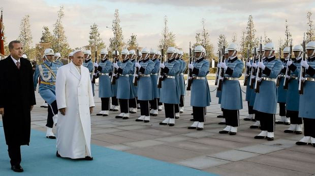 Pomp and ceremony:  Pope Francis and Turkish President Recep Tayyip Erdogan, left, walk by the honour guard at the ...