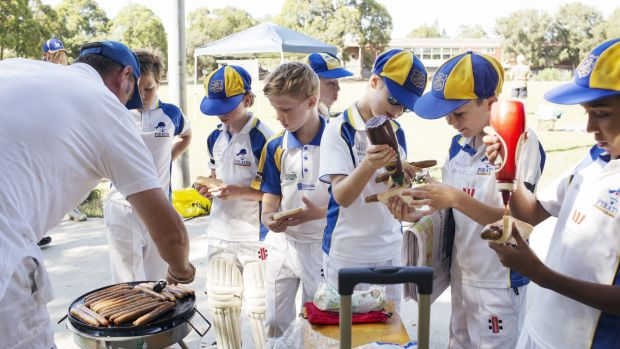 After the match: Under 11s hit the sausage sizzle.