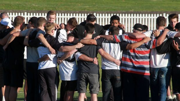 Emotion: Western Suburbs players gather at Pratten Park to remember Phillip Hughes.