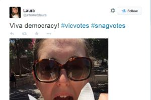 A Twitter user shows off her purchase from a sausage sizzle at a polling booth.
