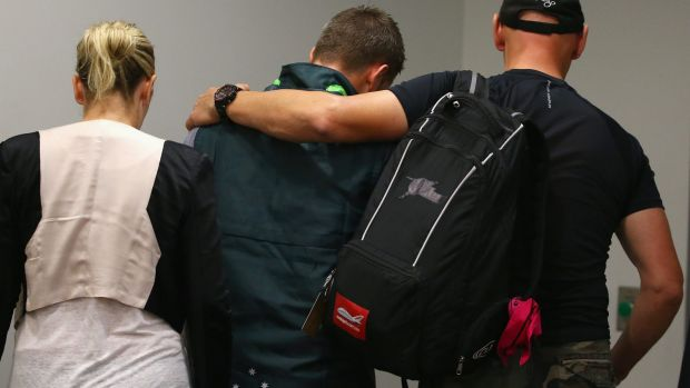 Distraught: Michael Clarke leaves the room after reading a statement on behalf of the team.