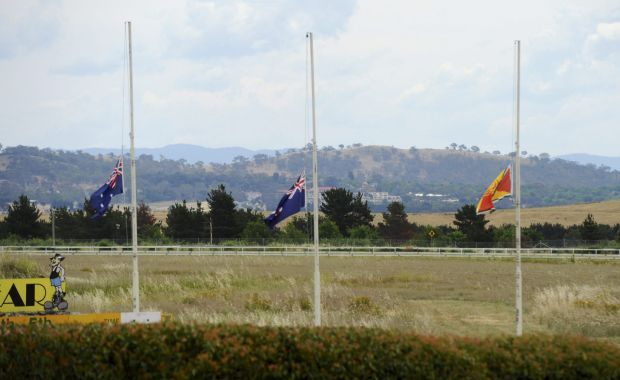 The flags around the course flew at half mast in respect for cricketer Phillip Hughes.